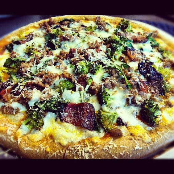 Homemade pizza! Italian sausage crumbles, black forest cured bacon, rappini, broccoli, freshly shredded mozzarella, & grated piave cheese on wheat crust made from scratch... Phew! Worth every bit of the work involved!! :)