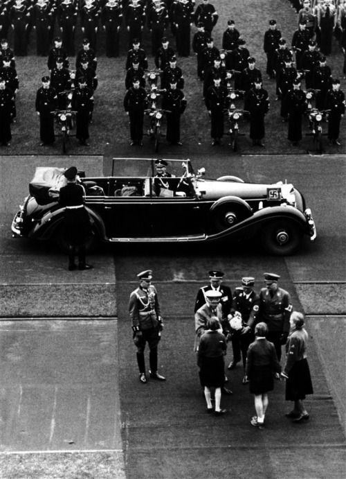 Adolf Hitler greets a group of girls before giving a May Day speech to members of the Hitler Youth and its sister organization, the Bund Deutscher Madel (League of German Girls), at the Lustgarten, Berlin, 01.05.1939.