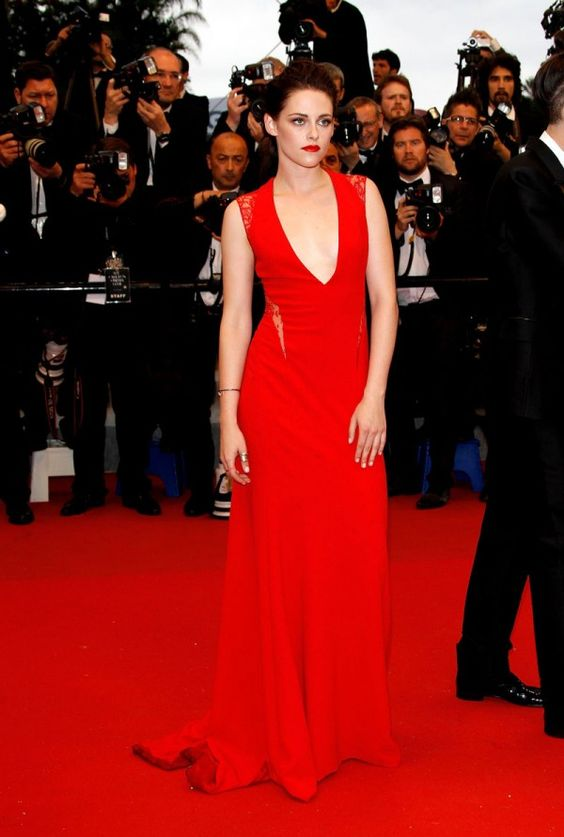 May 25, 2012: Kristen Stewart attends the Cosmopolis premiere during the 65th Annual Cannes Film Festival in a red gown from Reem Acra's Pre-Fall 2012 collection. #red