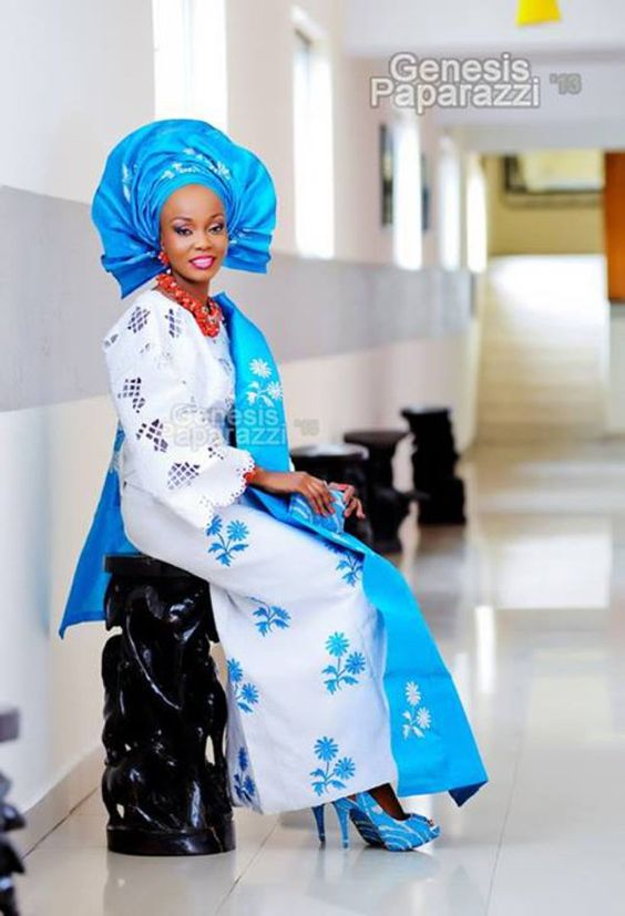 Is she stunning??? Yoruba bride repping in a beautiful blue and silver traditional attire for her big day. Those red beads...great contrast!: