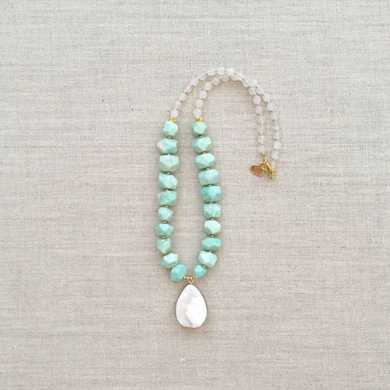 A Loves Affect Original The Brynn Pendant Necklace is composed of minty amazonite nuggets, clear agate, gold brushed accent beads and one white druzy pendant. Necklace is strung on extra durable, nylon coated stainless steel wire and measures out to be 20 in length.  ♥ Please be aware that due to the unique and handmade nature of each product, colors, shapes, and bead sizes may vary slightly from the photos and descriptions.  ♥ Please treat your jewelry gently, as some materials can be…