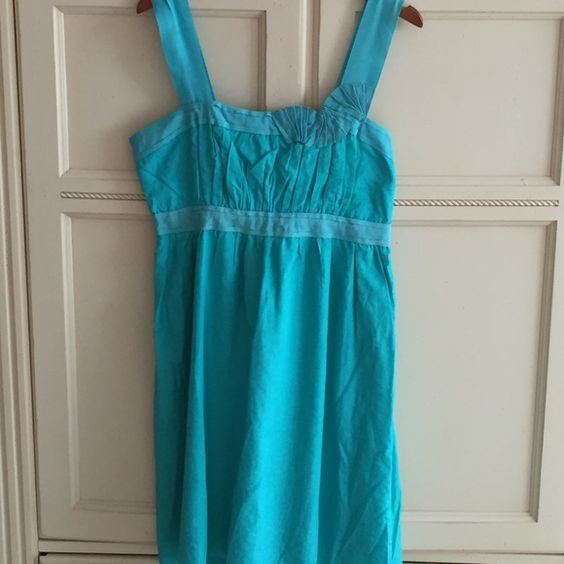 Ariella umpire waist dress with ribbon accent Ariella umpire waist dress with ribbon accents . Cool and comfortable to wear. Dress is in beautiful condition. Ariella is a British company. They are sold in better stores. Ariella Dresses