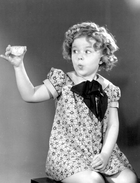 """Shirley Temple and a tea cup. """"Is this how you hold the cup?"""" she asked of no-one in particular."""
