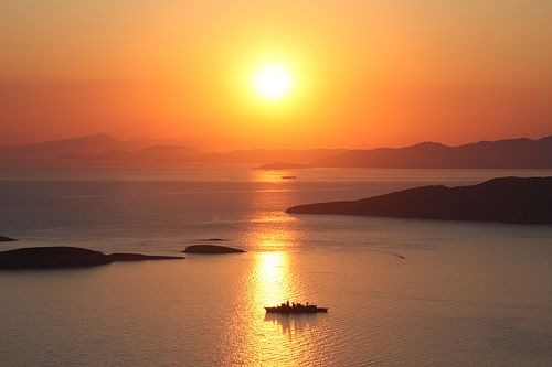 The sun sinking in the water horizon of Andros island, just perfect!