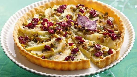 Sweet apples and cranberries balance the sharp flavor of blue cheese in an eye-catching appetizer tart.