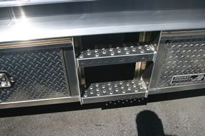 This picture show at step option built into a Highway Products flatbed. We have lots of options to choose from. To see more go to our web site at highwayproducts.com