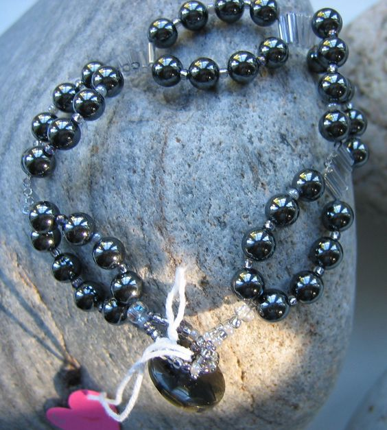 Faye - haematite, seeds, bugles and mother of pearl button fastener £20