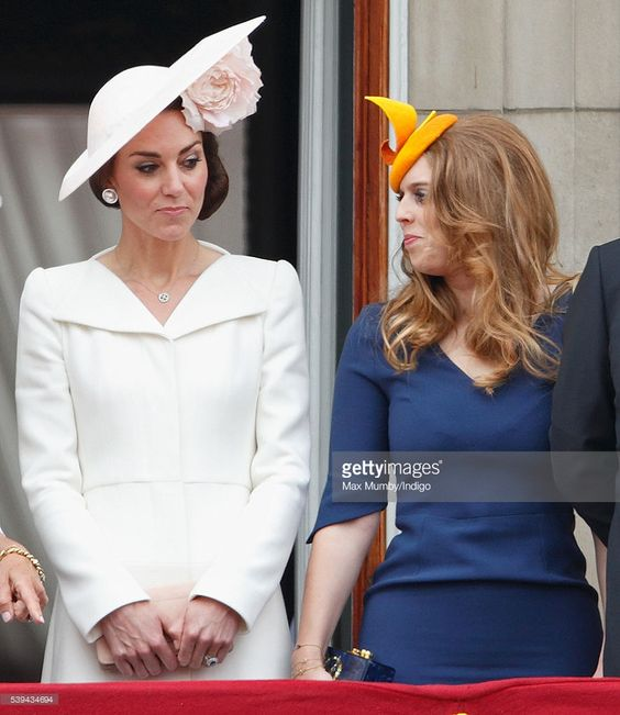 Catherine, Duchess of Cambridge and Princess Beatrice stand on the balcony of Buckingham Palace during Trooping the Colour, this year marking the Queen's 90th birthday on June 11, 2016 in London, England. The ceremony is Queen Elizabeth II's annual birthday parade and dates back to the time of Charles II in the 17th Century when the Colours of a regiment were used as a rallying point in battle.:
