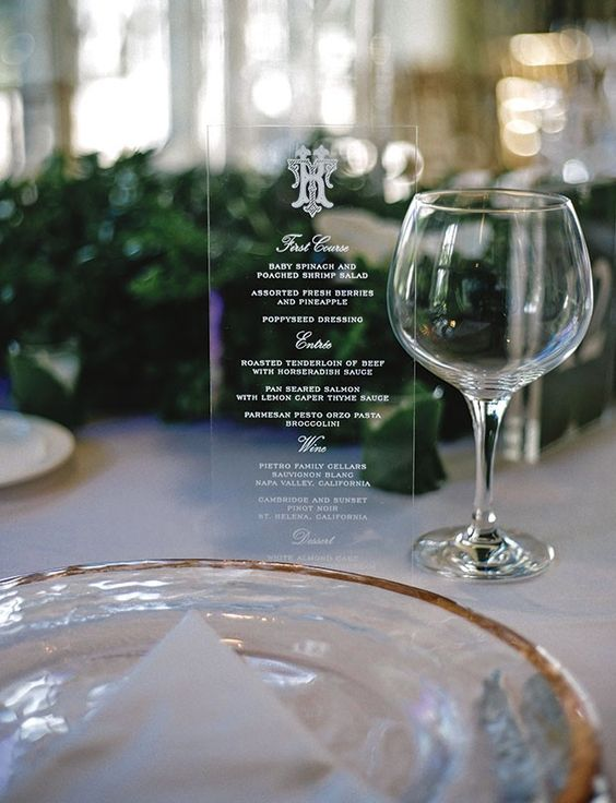 Acrylic menus by Sarah Allen Preston Designs decorated the table settings at this wedding reception