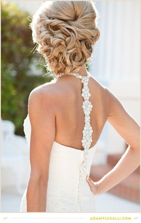 Twisted and curled hair into a low chignon. Perfect for a wedding hairstyle with a veil or for any other special occasion.
