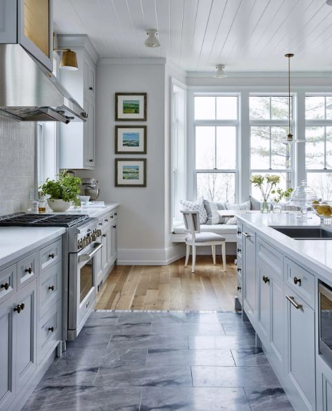 Kitchen with light grey cabinets and brass hardware by Sarah Richardson for her off the gird modern farmhouse in Ontario. #kitchen #modernfarmhouse #lightgrey #SarahRichardson