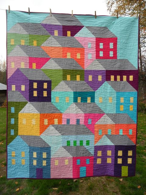 These fun colorful houses were quilted by Cathy from Blueberry Patch using Aurifil 2600. The link for the quilt pattern is in the blog post.  To see more please visit http://cathy-blueberrypatch.blogspot.com/2015_11_01_archive.html: