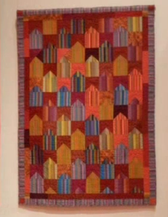 Kaffe Fassett quilts, in general, tend to use complicated shapes for nearly solid color fabrics, and larger, easily read shapes for prints. Color harmony is the main feature, with only occasional black or white when it successfully emphasizes the color. myb