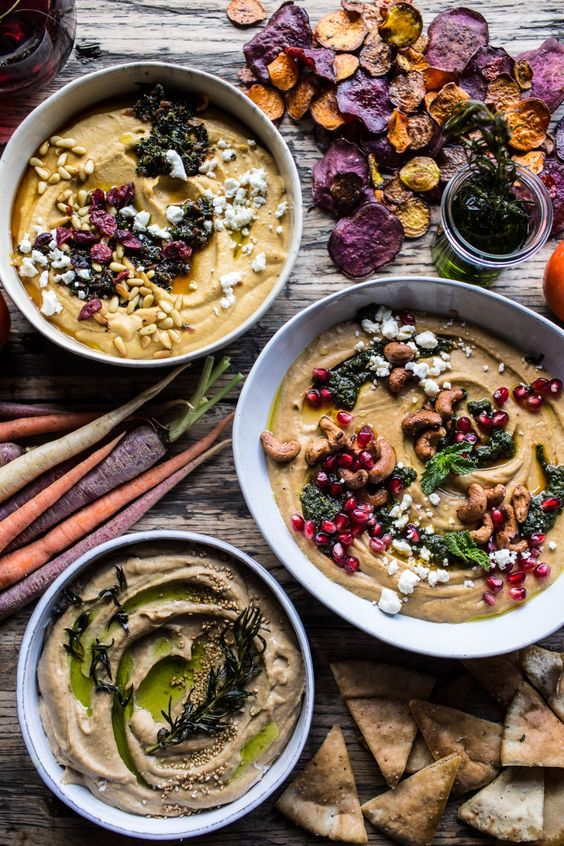 The Big Holiday Hummus Board with Roasted Root Veggie Chips - beautiful & delicious, you'll have smiles on all your guests faces, from halfbakedharvest.com