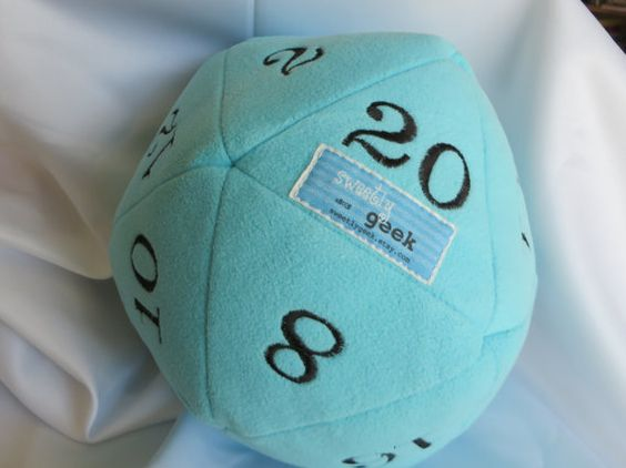 Awesome geeky baby gift: A handmade clutch ball that's a plush d20 die.