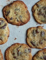 """Chocolate-Cherry Cookies """"Rich with dark chocolate and brown sugar, the cookies have a melting softness that's punctuated by tart dried cherries."""""""