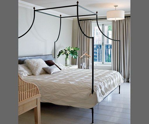 """French Impression : News, Culture + Travel : Architectural Digest.  The master bedroom features an iron bed. """"I was always praying that I would get a French architect or someone with that French mentality to help me,"""" says the client. Great Plains drapery fabric.  Kathryn Scott Design Studio."""