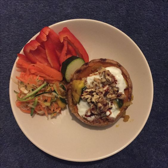 Squash stuffed with squash sabji, topped with yogurt, roasted walnuts and date syrup / carrot, courgette and cabbage coleslaw.
