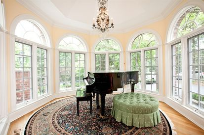 Gorgeous piano room with large windows.