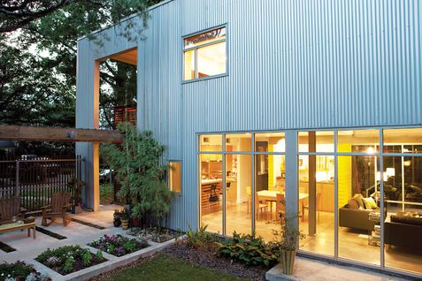 Aluminum #cladding.  super dwell. #metal #windows #garden #vegetation #inside/outside