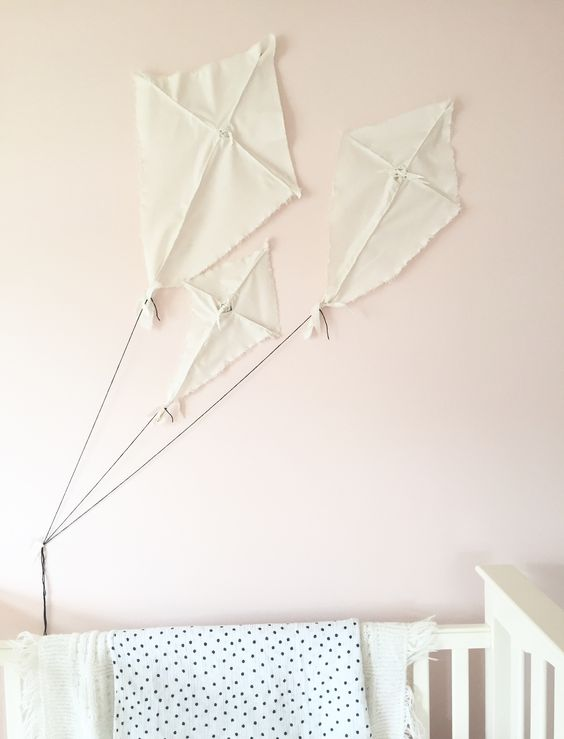 Baby girl nursery kites inspired by hgtv's Fixer Upper. Paint: Sherwin Williams Pink Dogwood
