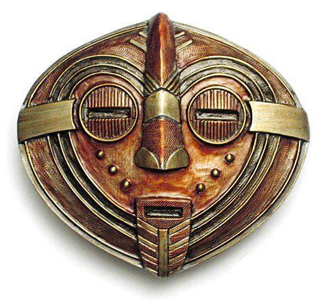 Elaborate belt buckle. I like the copper: Folk Art Masks From Africa | AFRICAN MASK Belt Buckle Tribal Art Review