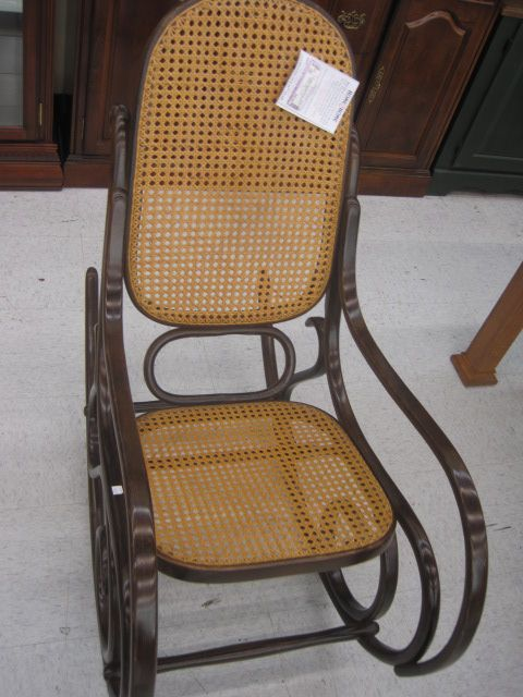 20 x 46 x 41 Dark wood bentwood rocking chair. Has cane seat and back ...