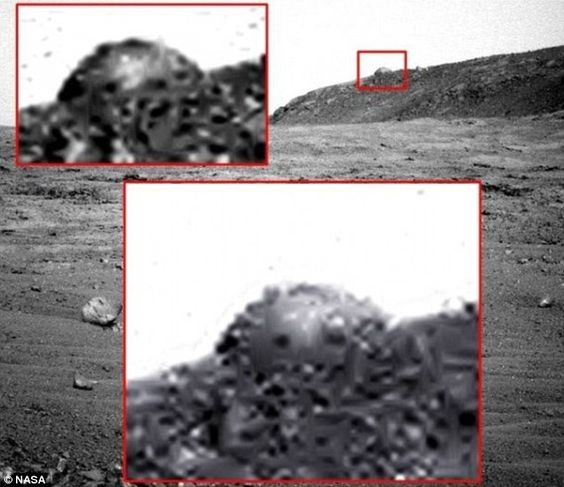 UFO hunters' latest 'sighting' of a rock is described as a 'man-made dome' that they say was left behind by an alien race sometime during Mars' watery past. The image was taken by Nasa's Opportunity rover