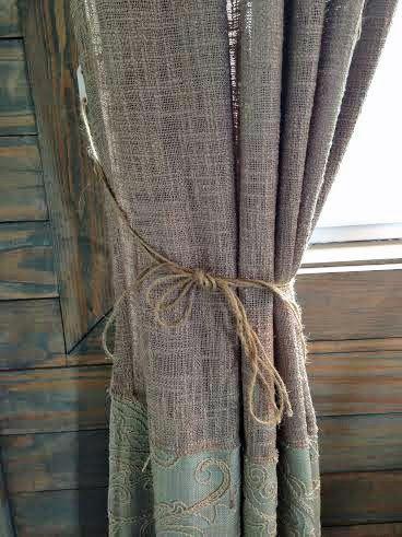 Tie back burlap curtains with twine...genius! Rustic chic ...