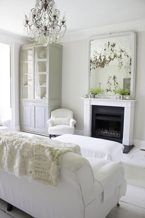 "Fireplace in white on white room. Multiple shades of white mix for a glorious cloud-like interior. Scandinavian style white Nordic French design details as well as spare decor style meet English countryside charm in ""The Hatch,"" a photographic location in Wiltshire. Design: Atlanta Bartlett & Dave Coote of the Beach Studios. #scandinavian #interiordesign #fireplace #whitedecor #frenchnordic #nordicFrench #Swedishstyle #serene #shabbychic"
