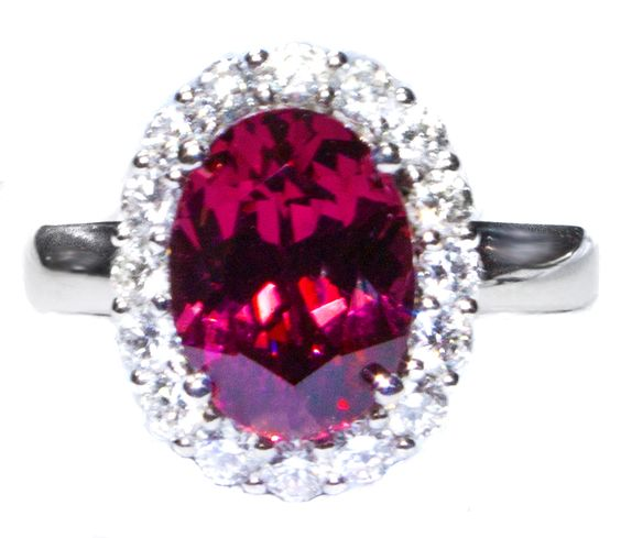 Malaya Garnet & Diamond Ring in solid 18k white gold.  The diamonds are bright and sparkling and matched to perfection.  This garnet is richly saturated and AAA in quality.
