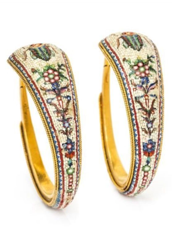 A Pair of Archaeological Revival Yellow Gold Micromosaic Hoop Earrings, French. Consisting of a multicolour scarab and foliate motif micromosaic inlay against a white background, accented with an intricate blue, red, and white geometric edging and rope texture gold border. With French owl import mark. #antique #ArchaeologicalRevival #earrings: