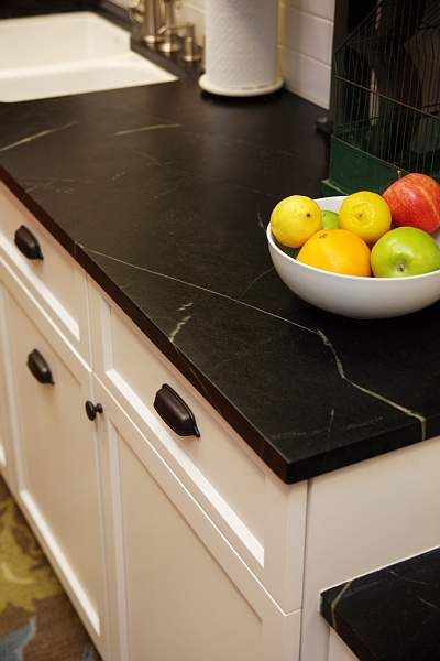 Here we have some jet black soapstone to give off an elegant touch on the white cupboards. With the smaller streaks of white running through you get just enough of a tie-in without too much taking away from the black.