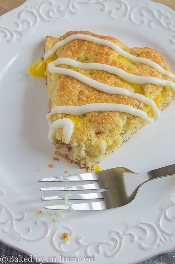 Peach Almond Scones - Loads of juicy peaches and toasted almonds take these homemade scones to a whole new level! They're moist, tender, and have chunks of peaches in every bite. Topped with a thick, sweet almond drizzle.