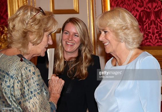 Camilla, Duchess of Cornwall laughs with her daughter Laura Lopes and Annabel Elliot she hosts the 30th Anniversary Garden Party for the National Osteoporosis Society in St James Palace on July 12, 2016 in London, England. Due to inclement weather the event was moved indoors. The Duchess of Cornwall has been connected with the charity for nearly 30 years.  (Photo by Chris Jackson/Getty Images)