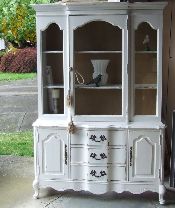 Distressed bassett french provincial china hutch with burlap backing