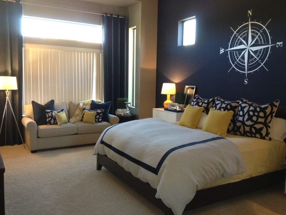 Blue wall with nautical symbol!; white duvet, white euro shams; three anchor…