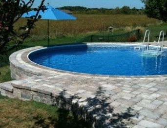 Kayak pools midwest recessed pool swimming pool ideas for Half in ground pool ideas