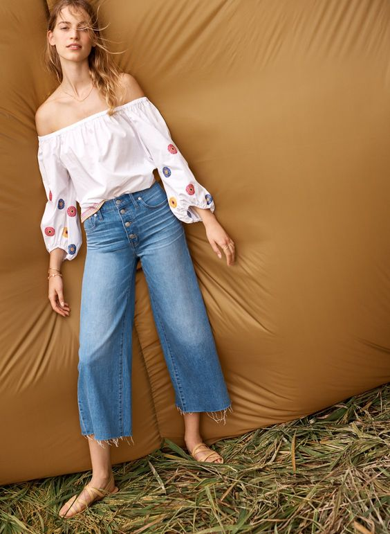 madewell wide-leg crop jeans worn with embroidered off-the-shoulder top + the boardwalk multistrap sandal.