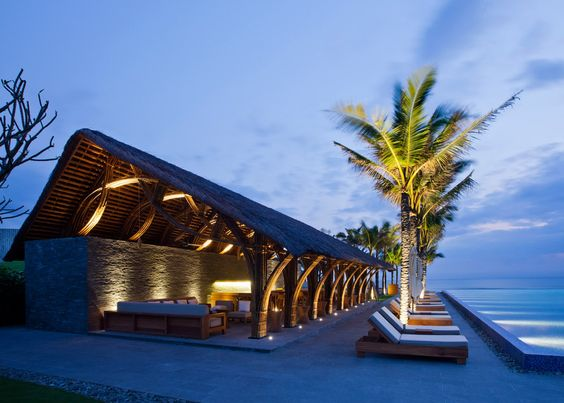 Architect Vo Trong Nghia has added new bamboo buildings to the Naman Retreat, a luxury resort and spa on Vietnam's spectacular coastline near Da Nang. The new buildings, housing a restaurant with soaring bamboo pillars and a beach bar that looks out onto crystal blue water, are additions to the existing hotel and spa facility. The bamboo beams and thatched roofs of the new buildings allow guests to feel as though they have been swept away to an exotic yet luxurious island.: