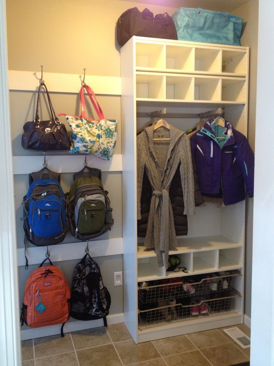 Mud room: I like that coat rack. Idea for the old tv hutch turned coat closet, and the wire basket drawers for the bottom shelving?