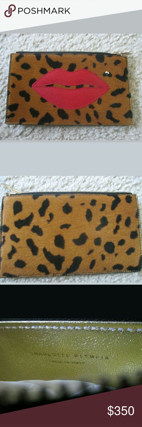"""Charlotte Olympia Pouty clutch purse Pony hair NEW Charlotte Olynpia  Pouty Purse  Brand New never used still has tissue paper inside  Animal Print    Zips Closed  This petite zip-up pouch in hyena printed pony hair is kissed by iconic Charlotte Olympia red lips and finished with a brass stud beauty spot.  Authentic   Pouch with appliqu? lips and beauty spot detail. Printed ponyskin.   Width: 6.8""""/17.5cm. Height: 3.9""""/10cm    Made in Italy.  This item will only be shipped to a confirmed…"""