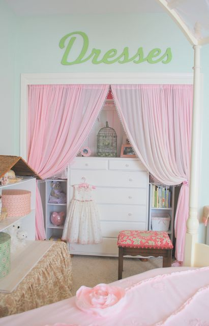 Curtains and wooden letters in closet (dresses or dress up)