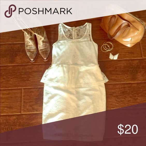 White Peplum Dress Adorable white lace peplum dress. It would be precious with boots or heels! Dresses Mini