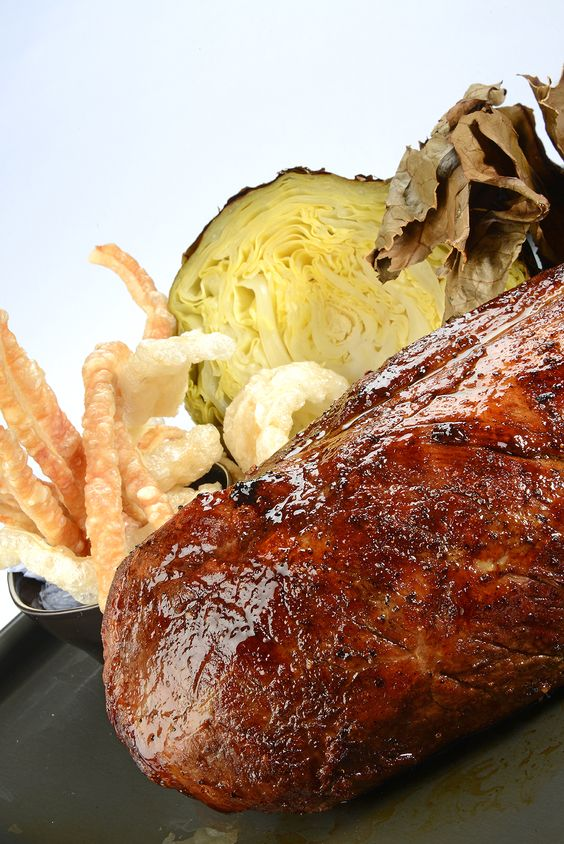 Nigel Haworth's delicious pork rib-eye recipe makes a fantastic, autumnal alternative to a traditional roast dinner, complete with crisp crackling and a vibrant array of colourful cauliflowers.