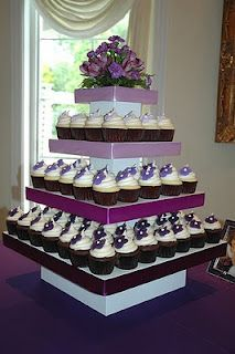 Purple wedding theme? And who said cupcake tiers always had to be arranged in a circular way?