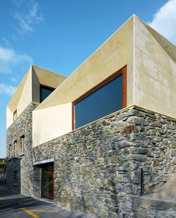 clavienrossier architectes :: it was a barn conversion in Switzerland... I love the contrast between the old stone and new construction.  The interior is fantastic as well...