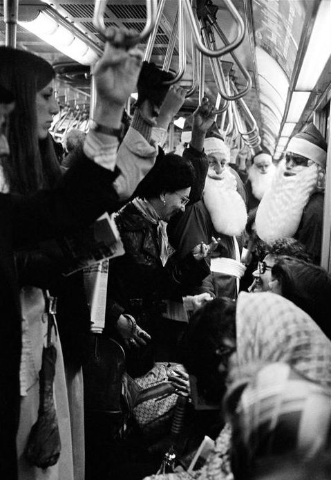 NYC. Santas at the subway, 1977. Are the reindeers carrying the train?