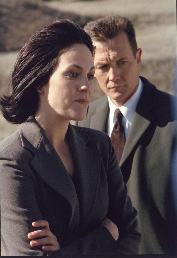 """""""X-Files"""" stars Annabeth Gish (left, as Monica Reyes) and Robert Patrick (right, as FBI Agent John Dogget), from Season 8 of the hit show."""
