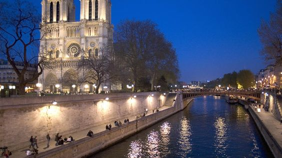 Sipping wine and hanging out on the Seine with friends in the Summer, on the other side of Paris' Notre Dame. That's my favorite!